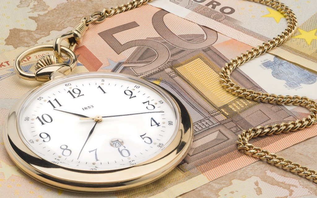 Euro Notes and Pocket Watch