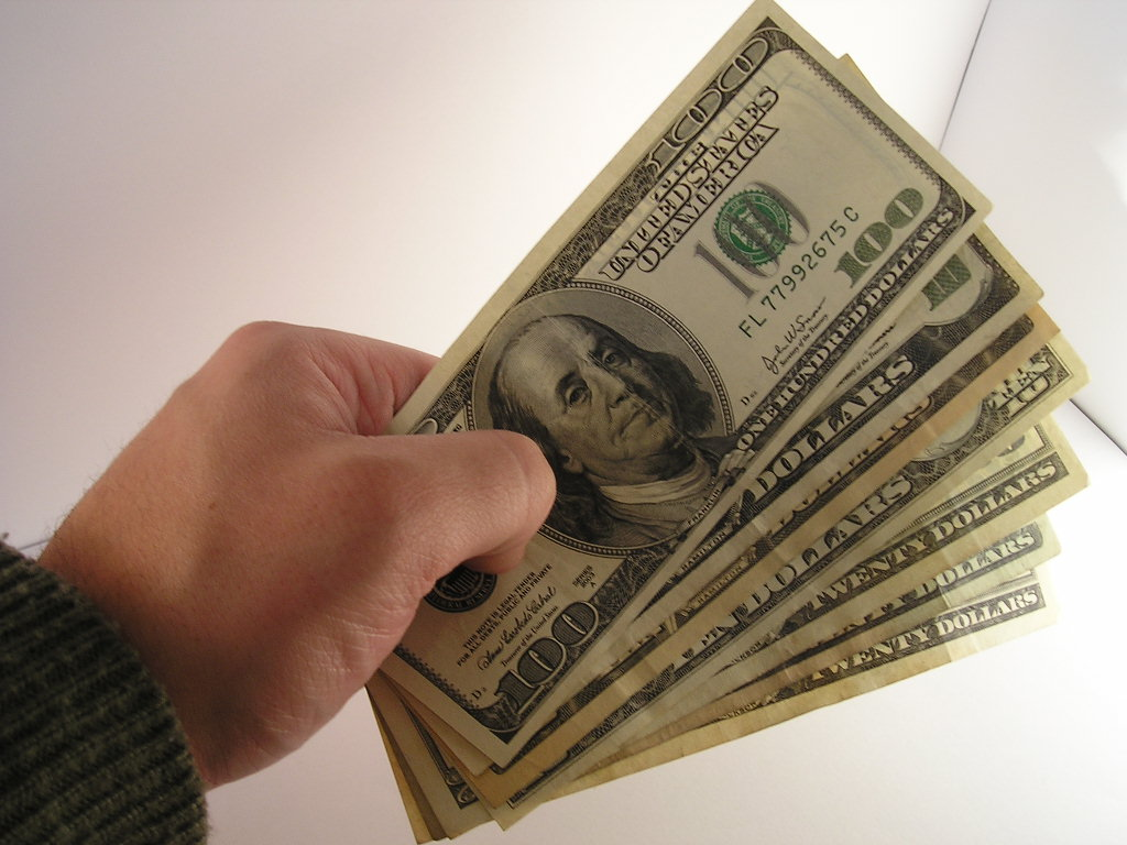 Hand with 100 Dollar Bills