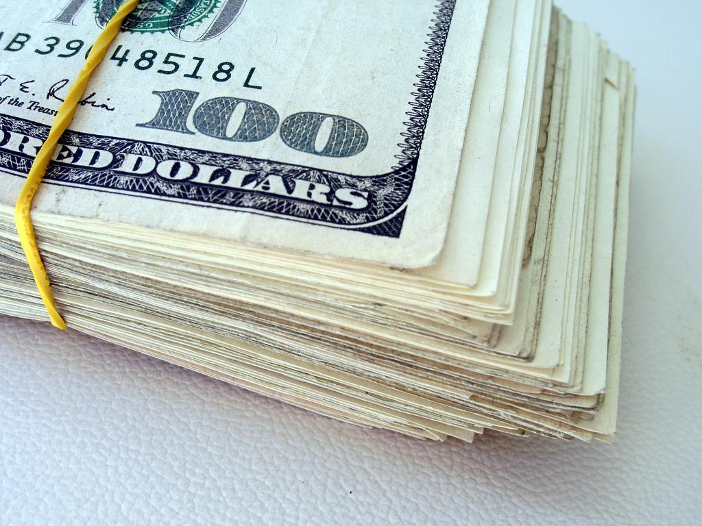 rubberband 100 dollar bill stack